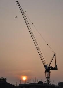 Construction-crane-sunset_pos-statement